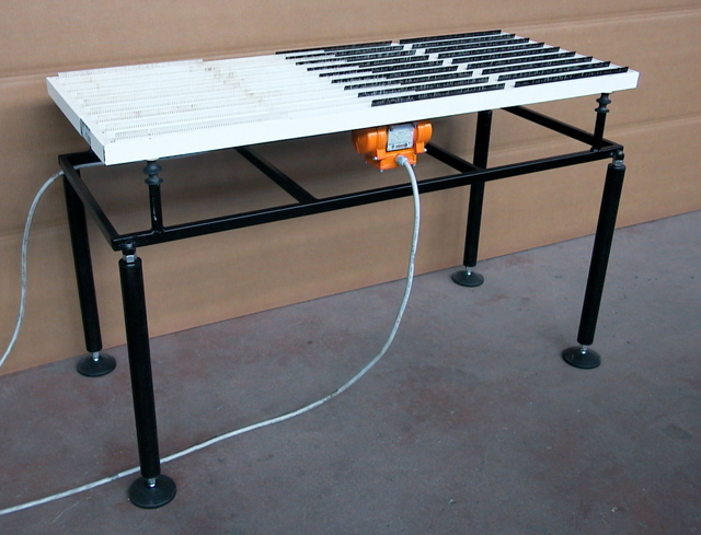 Low friction vibrating table for handling sheet metal